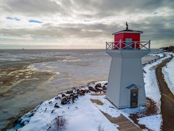 lighthouse in winter cold snow