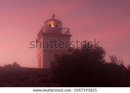 Lighthouse is in the morning fog. Kangaroo Island. South Australia, Flinder's Chase National Park