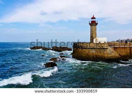 lighthouse on a pier on the Atlantic ocean coast in Porto, Portugal