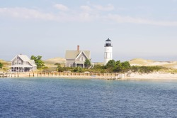 Lighthouse on Cape Cod With Beach And Water