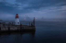 Lighthouse on foggy night in St John Nova Scotia Canada