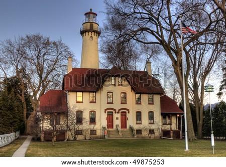 Lighthouse on Lake Michigan at sunset