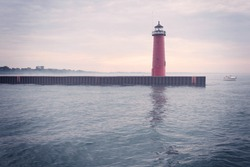 Lighthouse on Lake Michigan on a foggy day