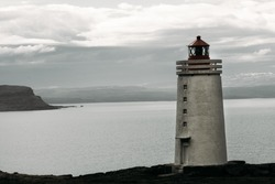 Lighthouse on mountain in shrouded weather, Iceland