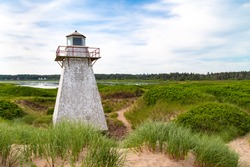 Lighthouse, on PEI, Prince Edward Island Canada. St. Peter's Habour Lighthouse, stands, surrounded by sand dunes.