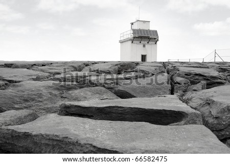 lighthouse on rocky landscape of the burren in county clare ireland
