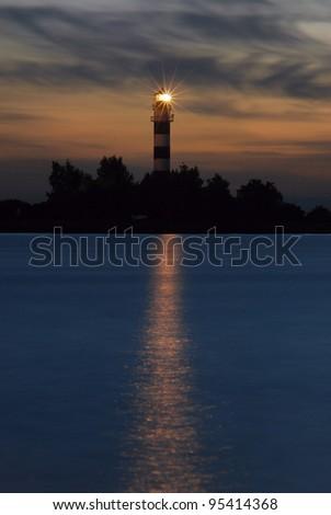 Lighthouse on the Daugava river at sunset. Port of Riga