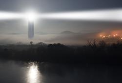 lighthouse on the fog