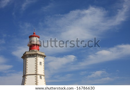 Lighthouse on the portuguese coastline with a beautiful blue sky