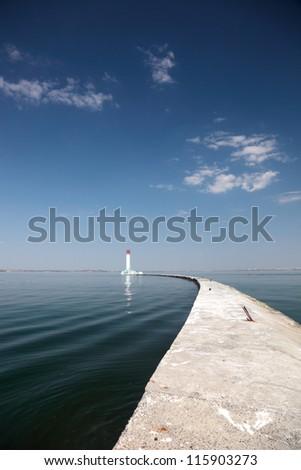 Lighthouse on the quarantine pier at the Odessa sea port on the Black Sea. - stock photo