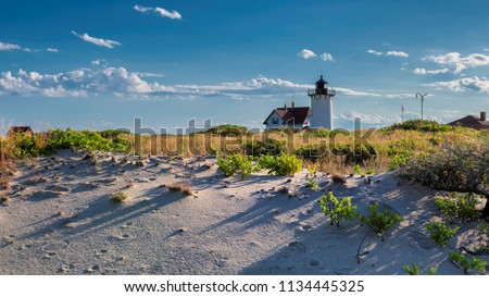 Lighthouse Point on beach dunes. Race Point Light Lighthouse in Cape Cod, New England, Massachusetts, USA.