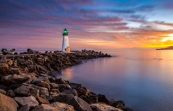 Lighthouse sea rock sunset landscape. Sunset lighthouse scene. Lighthouse sunset view