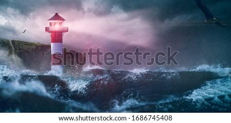 Lighthouse sea waves rain storm