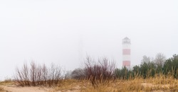 Lighthouse standing in the fog