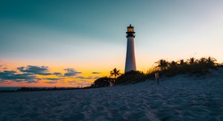 lighthouse sunset sea ocean florida aquatic sky lighting sun coast beach silhouette sunrise cloud dusk orange landscape tower coast