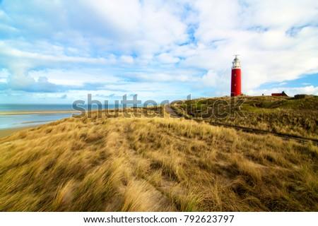 Lighthouse Texel on Blue Cloudy Sky background Outdoors. Nationalpark Duinen van Texel, Texel Island, Netherlands #792623797
