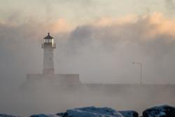 lighthouse through the lake fog