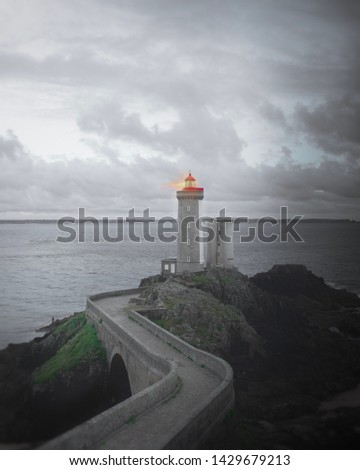 lighthouse with a moody sky  #1429679213