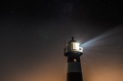 Lighthouse with a sky full of stars