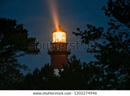 lighthouse with beam of light #1202274946