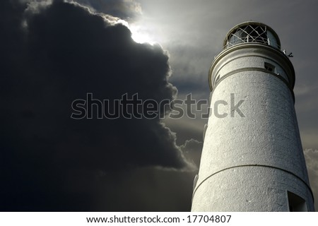 Lighthouse with storm clouds approaching.