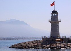 Lighthouse with the Turkish flag, in Alanya port, Turkey