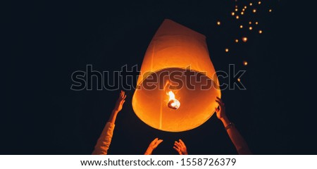 Lighting candles, lanterns in the sky at night in the Lantern Festival