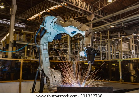 Lighting from robots welding steel.