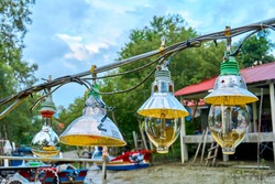 Lighting lamps on an old small fishing boat