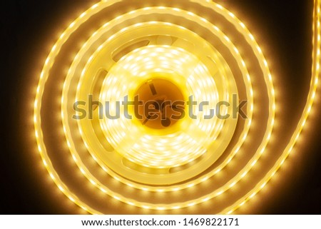 lighting led tape,diode tape warm spectrum,round glowing garland close-up