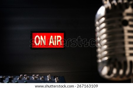 lighting of on air signboard in sound studio and retro  microphone is foreground