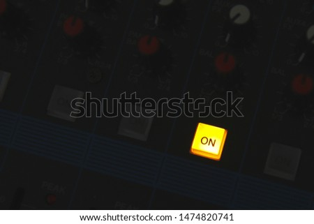 Lighting On Button on Audio sound mixing console control panel and buttons of digital studio turntable dj mixer.