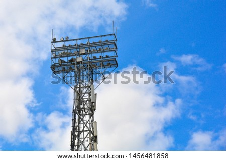 Lighting support. Stadium Post Lighting. Tall pillar with spotlights to illuminate a football stadium against the sky with clouds #1456481858