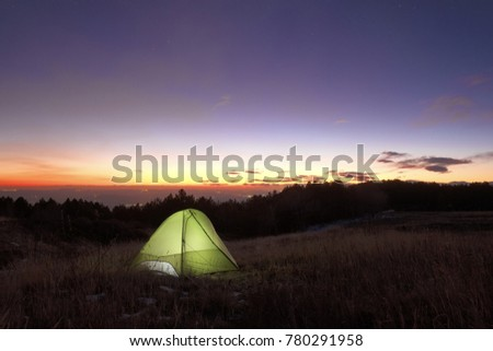 lighting tent at the sunset from Galvarina highland in Etna Park, Sicily #780291958