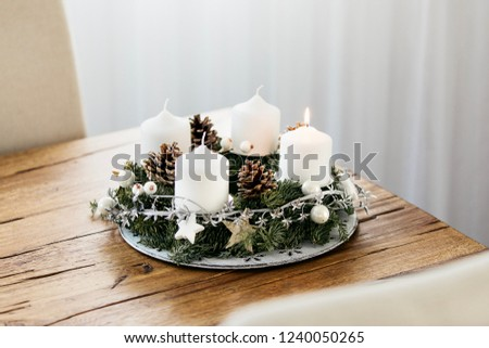 Lighting the first candle on the Advent Wreath on the first Sunday in December to celebrate the beginiing of Christmas holidays in Switzerland.