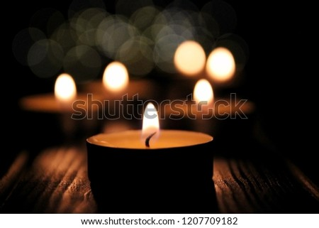lightining candles on dark background #1207709182