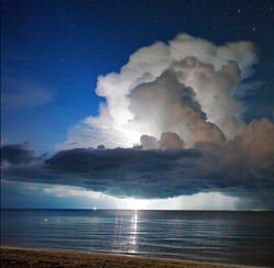 Lightning above the sea in tome of storm. Thailand