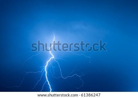 lightning against blue sky