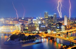 Lightning among skyscrapers in downtown PIttsburgh, Pennsylvania, USA.