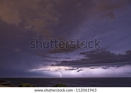 Lightning bolt and storm clouds over the horizon at Zonqor Point in Marsascala Malta