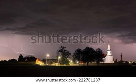 Lightning bolts over church