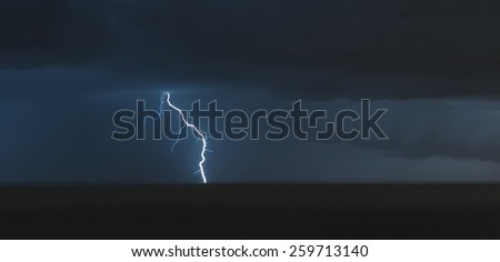 lightning bolts over the sea