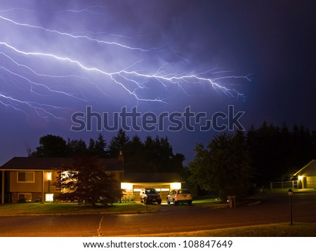 Lightning Flashes Across a Stormy Night Sky - stock photo