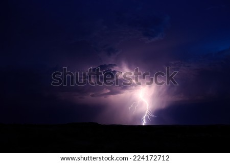 Lightning flashes from a thunderstorm over the Arizona Strip in northern Arizona, USA.