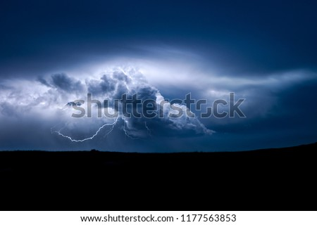 Lightning from a distant prairie thunderstorm
