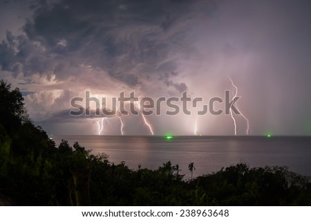 Lightning in the sea during the night storm