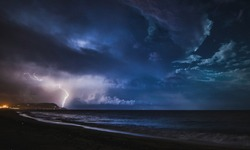 Lightning in the sea, Italy.