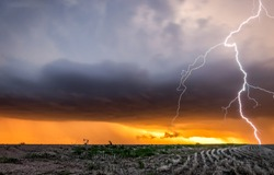 Lightning over a field in a thunderstorm. Thunderbolt in sky. Lightning in sky. Dark clouds lightning