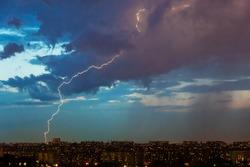 Lightning over the city evening