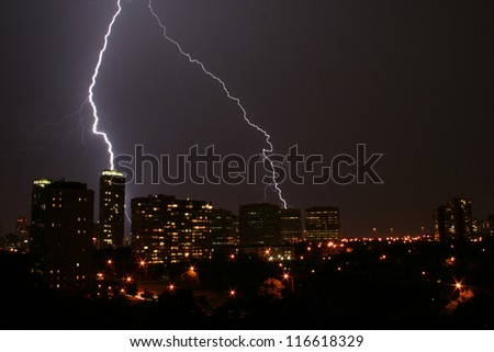 Lightning Skyline. Lightning striking along a city skyline at night.